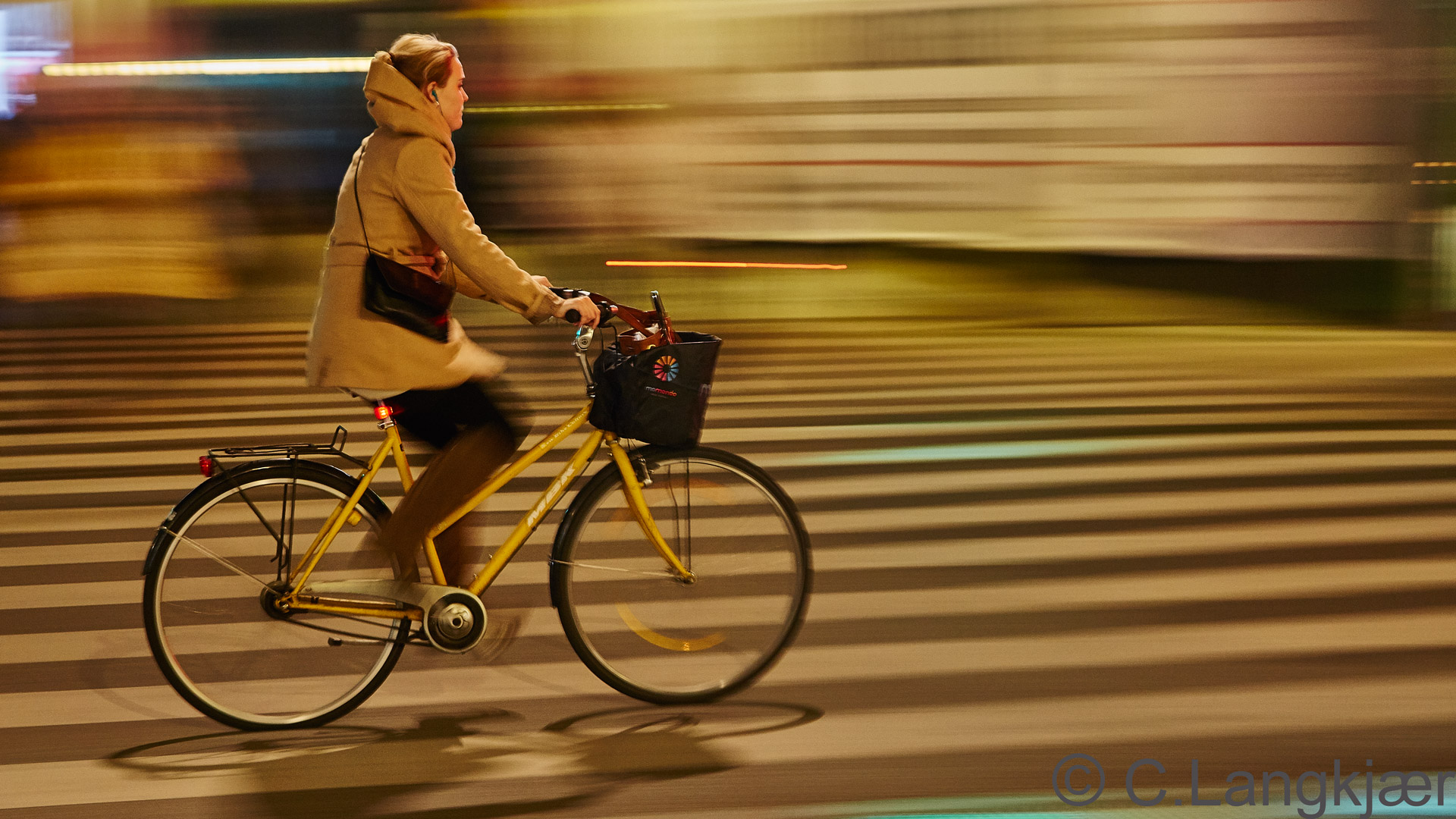 Yellow bike under young woman